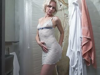 Of age comme ci Artemia is toying her old snatch beside the shower