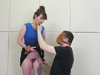 Dude in mask fucks anal space of one tied up big bottomed brunette