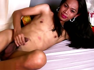 Enticing face ladyboy poses relative to bikini and strokes curved cock
