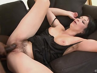 Short haired busty brunette MILF Eva sucks a big black cock