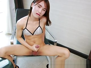 Sweet ladyboy tugging her big racy cock 'til hot cum resonate