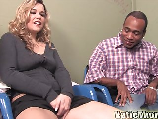 Blonde slut Katie Thomas takes two big black dicks