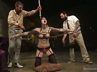 Tattooed plighted hooker Nikki Hearts is fucked by several perverts in the dark room