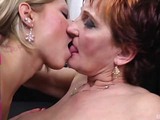 Mature lady together with her lesbian girlfriend please each other's cunts