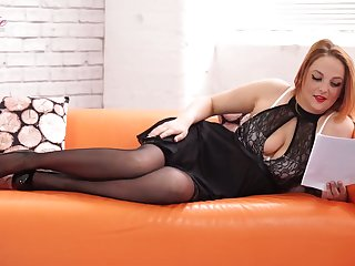 Red haired milf Kara Carter tells erotic stories in sexy lingerie together with stockings