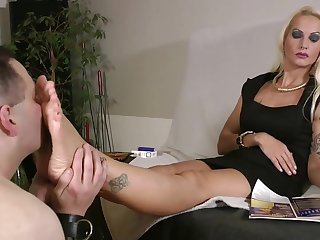 Platinum blonde tattooed mistress in black dress gets their way feet worshiped unconnected with naked fat slave