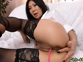 Horny thai milf loves having fun with her lush toy