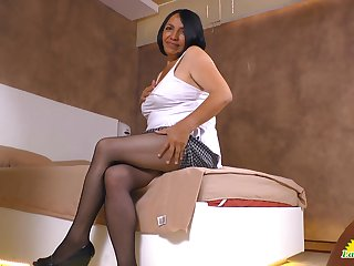 Chubby old Latin bitch Andrea shows off breakage and panties upskirt